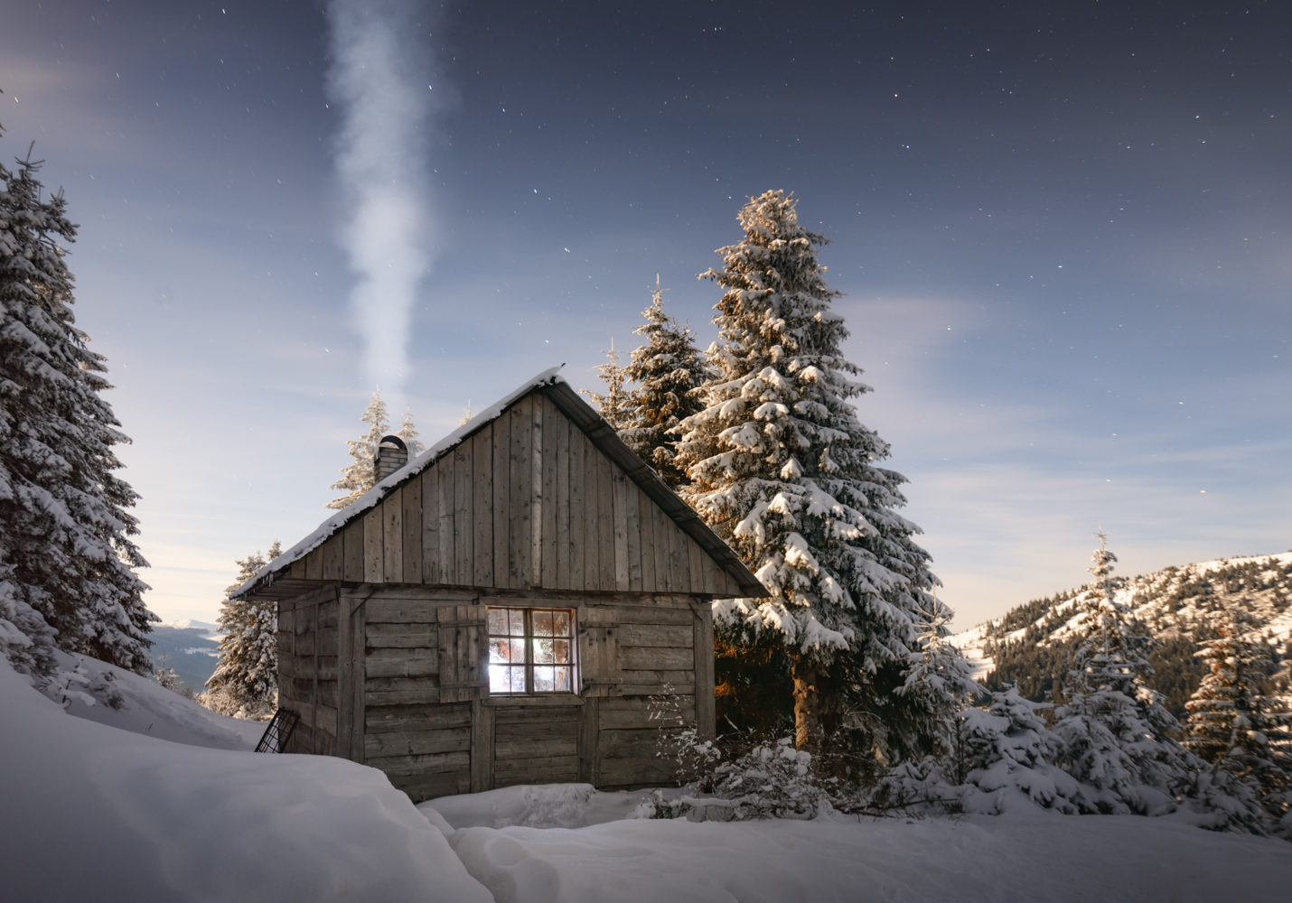Fantastic winter landscape with wooden house in the country